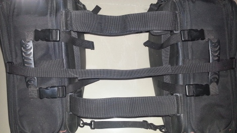 Velcro straps that are placed on top on the pillion seat